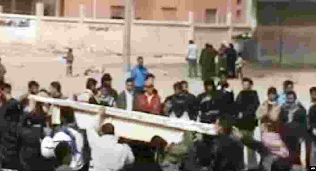 This image made from amateur video and released by Shaam News Network purports to Syrians carrying the coffin of a man killed by Syrian government forces during his funeral in Homs, Syria, March 13, 2012. (AP/Shaam)