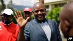 FILE - Burundi President Pierre Nkurunziza waves as he walks to his car after making a brief statement to the media at the presidential palace in Bujumbura, Burundi, May 17, 2015.
