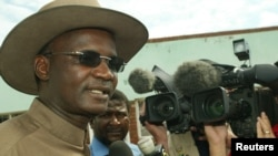 FILE - Former Minister of Information Jonathan Moyo talks to reporters before voting in Tsholotsho, Zimbabwe.