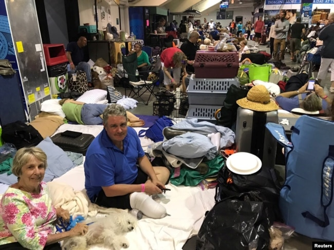 People take shelter from Hurricane Irma inside the Germain Arena in Estero, Florida, Sept. 9, 2017.