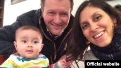 FILE - Richard Ratcliffe, center, is stepping up the fight to have his wife, Nazanin Ratcliffe, and daughter Gabriella released from Iran.
