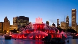 Chicago's Clarence Buckingham Memorial Fountain glows in bright red colors during one of its nightly summertime light shows