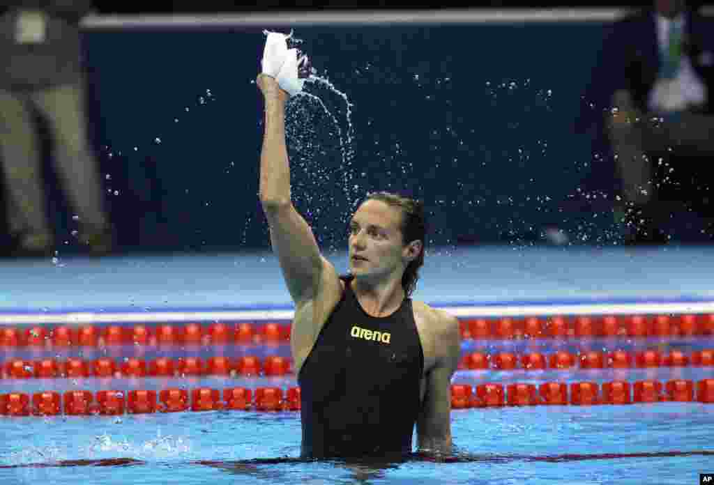 Hungary's Katinka Hosszu celebrates after setting a new world record and winning the gold medal in the women's 400-meter individual medley final during the swimming competitions at the 2016 Summer Olympics, Aug. 6, 2016.