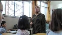 看天下: 叙利亚学校力图维持正常教学