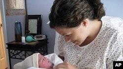 Karen Kramer with daughter, Stella Grace, shortly after giving birth at home.