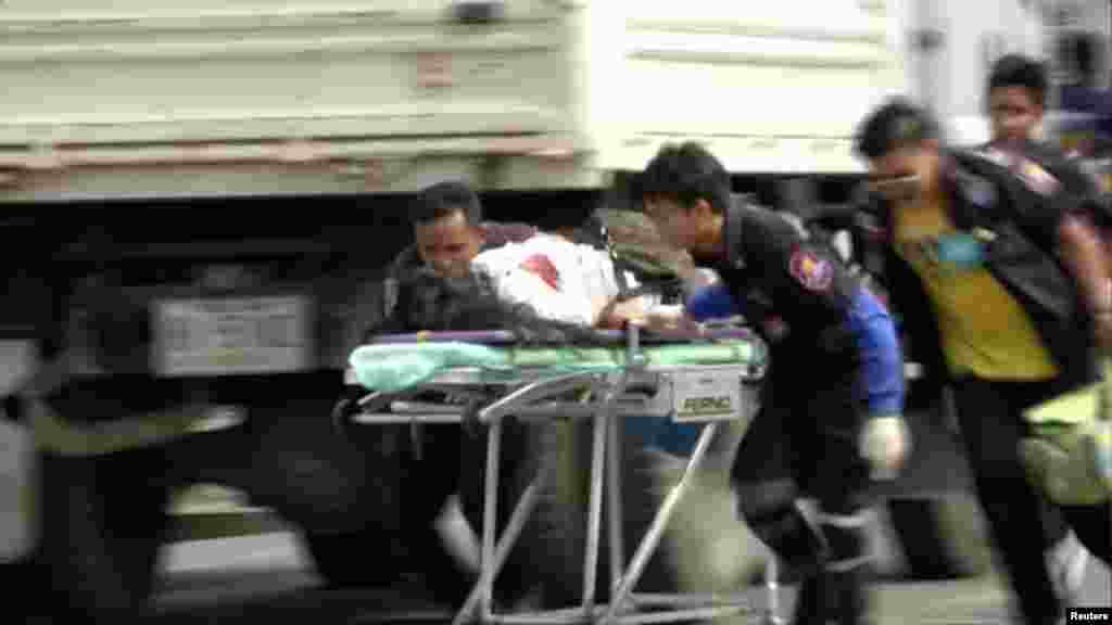Rescuers and medical officers push an injured person on a gurney at the site of a bomb blast in Hua Hin, south of Bangkok.