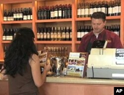 A customer pays for wine at the San Antonio Winery store
