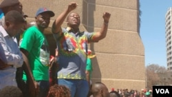 Kudzai Chipanga addressing Zanu PF supporters at the party's headquarters on Sunday.
