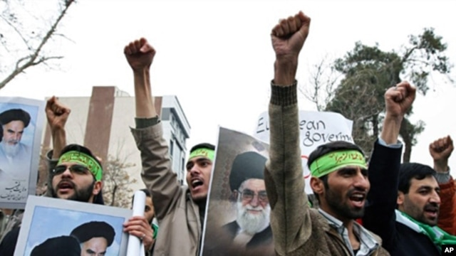 Demonstrators shout slogans and hold portraits of Iranian supreme leader Ayatollah Ali Khamenei (C) and founder of the Islamic republic Ayatollah Ruhollah Khomeini (2nd L) during a protest outside the Italian embassy in Tehran, 09 Feb 2009