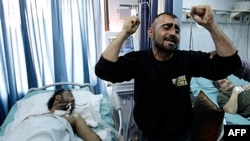 A Syrian man reacts in dispair to his brother's condition: seriously wounded during violence between security forces and armed groups in Latakia, northwest of Damascus, March 27, 2011