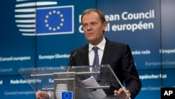 FILE - European Council President Donald Tusk speaks during a media conference at an EU summit in Brussels, March 19, 2015.