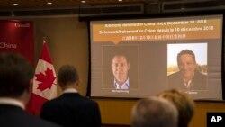 Ảnh của Michael Kovrig và Michael Spavor tại Đại sứ quán Canada ở Bắc Kinh hôm 11/8/2021.
