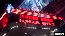 "FILE - A marquee advertising ""The Hunger Games"" is seen at the AMC Loews Lincoln Square Theater in New York, March 22, 2012."