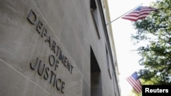 FILE - The exterior of the U.S. Department of Justice headquarters building in Washington, July 14, 2009.