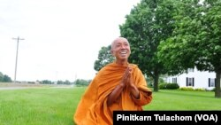 Buddhist monk Sutham Nateetong talks with VOA Thai after finished his daily walk outside Arcola, IN. June 8, 2019.