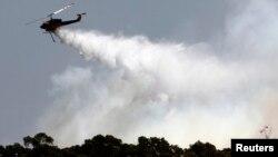 Ribuan warga di bagian selatan Australia hari Sabtu (3/1) mengungsi karena kebakaran hutan yang kian meluas dan sulit dipadamkan (Foto: ilustrasi).