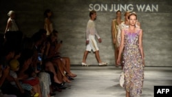 Models walk the runway at the Son Jung Wan fashion show during Mercedes-Benz Fashion Week Spring 2015 at The Pavilion at Lincoln Center, Sept. 6, 2014 in New York City.