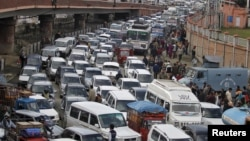 FILE - Vehicles jam a road in Srinagar, India, Oct. 26, 2015.
