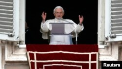 Pope Benedict waves as he leads his last Sunday prayers at the Vatican on February 24, 2013.