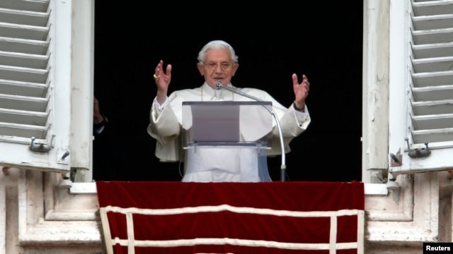 Pope Benedict waves as he leads his last Sunday prayers at the Vatican February 24, 2013.