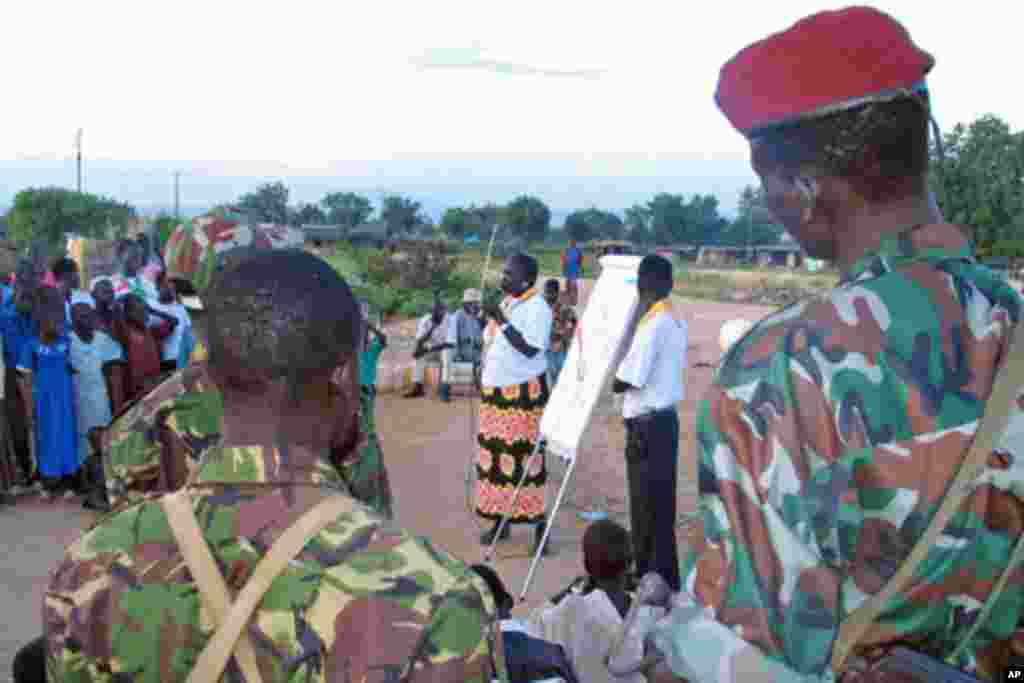 The recent report about a decline in HIV/AIDs infection rates in South Sudan should not be interpreted to mean that the disease is coming to an end. Instead, we should take this as an opportunity to change our ways. - James Mabusu in Maridi, Western Equatoria state A Sudanese aid worker talks to soldiers and scouts on how to spread the message on HIV/AIDS at an internally displaced camp in Juba, southern Sudan, October 2005. The HIV-infection rate in South Sudan fell slightly last year, a government report showed. (file photo)