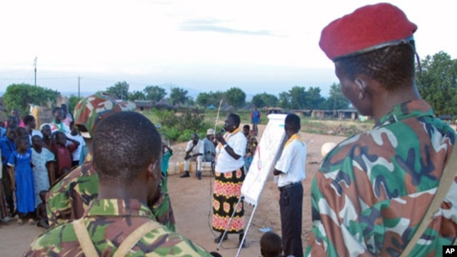 An aid worker talks to soldiers and scouts in Juba in October 2005, about how to spread the message on HIV/AIDS. HIV infections are down in South Sudan, a government report says. file photo)
