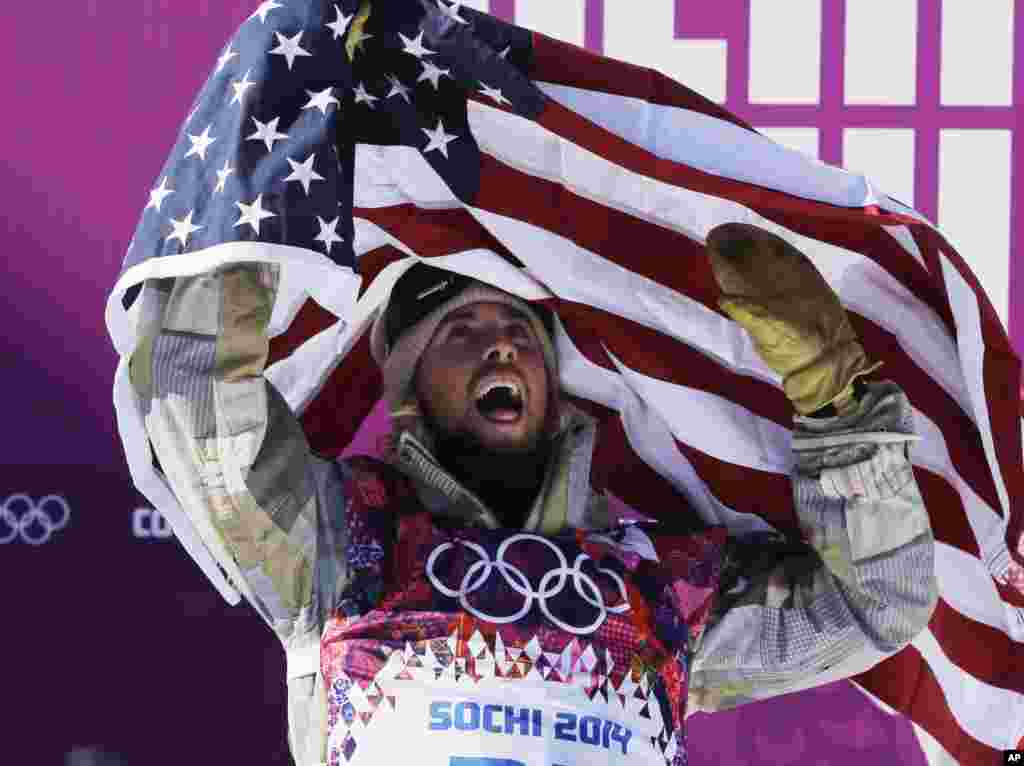 United States' Sage Kotsenburg celebrates after winning the men's snowboard slopestyle final at the Rosa Khutor Extreme Park, at the 2014 Winter Olympics, in Krasnaya Polyana, Russia.