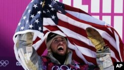 United States' Sage Kotsenburg celebrates after winning the men's snowboard slopestyle final at the Rosa Khutor Extreme Park, at the 2014 Winter Olympics, in Krasnaya Polyana, Russia, Feb. 8, 2014.