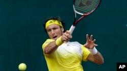 Juan Monaco mengalahkan Jeremy Chardy dengan skor 6-0, 7-6 dalam babak ketiga turnamen Barcelona Terbuka (foto: Dok).