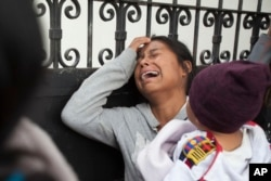 A relative of a youth who resided at the Virgin of the Assumption Safe Home wails as she waits for the release of the names of those who died in a fire at the shelter, outside the morgue where the bodies are being identified in Guatemala City, March 9, 2017.