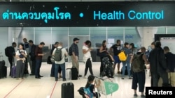 Tourist line-up in a health control at the arrival section at Suvarnabhumi international airport in Bangkok, Thailand, Januaruy 19, 2020