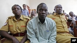 Thomas Kwoyelo, a former director of field operations in the rebel group Lord's Resistance Army appears before a War Crimes Court in Gulu, Uganda, July 2011. (file photo)
