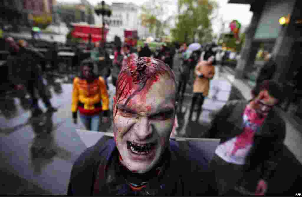 """An actor dressed as a zombie walks on a street in downtown Belgrade, Serbia, as part of a promotional campaign for the upcoming TV series """"The Walking Dead."""" The event is taking place over 24 hours in 26 cities around the world ahead of the show's U.S. pr"""