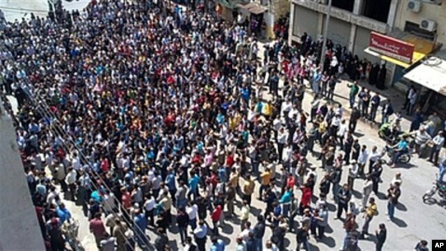 In this citizen journalism image made on a mobile phone, Syrian anti-government protesters gather in the coastal town of Banias, May 6, 2011