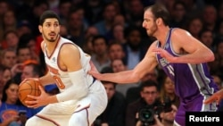 FILE - New York Knicks center Enes Kanter, left, controls the ball against Sacramento Kings center Kosta Koufos at Madison Square Garden in New York, Nov. 11, 2017.