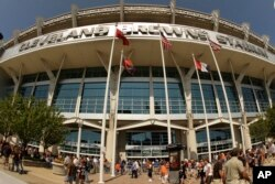"FILE - Fans walk into Cleveland Browns Stadium, Sept. 13, 2009, in Cleveland. A U.S. company boasted of the ""stunning visual effect"" its shimmering aluminum panels created in on the NFL stadium, an Alaskan school and a 33-story hotel on Baltimore's waterfront hotel."