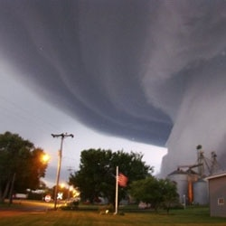 A huge funnel cloud touches down in Orchard, Iowa, on June 10, 2008