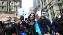 Protesters from Occupy Wall Street walk past the New York Stock Exchange dressed as zombies on Monday, October 3rd.