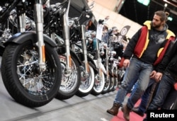 FILE - Harley-Davidson bikes are lined up at a bike fair in Hamburg, Germany, Feb. 24, 2017.