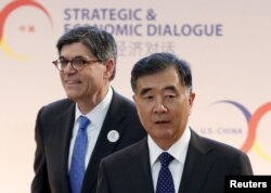 U.S. Treasury Secretary Jack Lew, left, and Chinese Vice Premier Wang Yang arrive at the Strategic and Economic Dialogue (S&ED) at the State Department in Washington, D.C., June 23, 2015.
