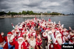 People dressed as Santa Claus take part in the World Santa Claus Congress, an annual event held every summer in Copenhagen, Denmark, July 23, 2018. (Ritzau Scanpix/Mads Claus Rasmussen)