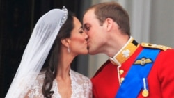 The first kiss: Prince William kisses his wife Kate, Duchess of Cambridge on the balcony of Buckingham Palace. (AP Photo)