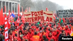 File - Workers and trade union representatives from all over Europe hold a demonstration against austerity near the European Commission and Council headquarters in Brussels, March 2013.