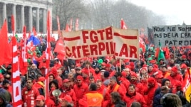 Workers and trade union representatives from all over Europe hold a demonstration against austerity near the European Commission and Council headquarters in Brussels, March 14, 2013.