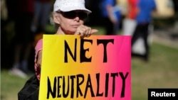 FILE - Lori Erlendsson attends a pro-net neutrality rally in Los Angeles, California, July 23, 2014.