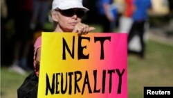 FILE - Lori Erlendsson attends a pro-net neutrality Internet activist rally in the neighborhood where President Barack Obama attended a fundraiser in Los Angeles, California, July 23, 2014. REUTERS/Jonathan Alcorn (UNITED STATES - Tags: CIVIL UNREST POLI