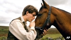 "Albert (Jeremy Irvine) and his horse Joey are pictured in this scene from DreamWorks Pictures ""War Horse"""
