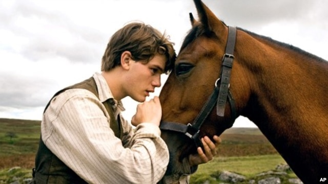 """Albert (Jeremy Irvine) and his horse Joey are pictured in this scene from DreamWorks Pictures """"War Horse"""""""