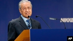 "Malaysian Prime Minister Mahathir Mohamad delivers a speech during the International Conference on ""The Future of Asia"" in Tokyo, June 11, 2018."