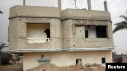 FILE - A broken and deserted house, which has a tunnel running underground, is seen in the Egyptian border city of Rafah, May 13, 2013. Egypt's says on Monday it found and destroyed 20 new tunnels last November.
